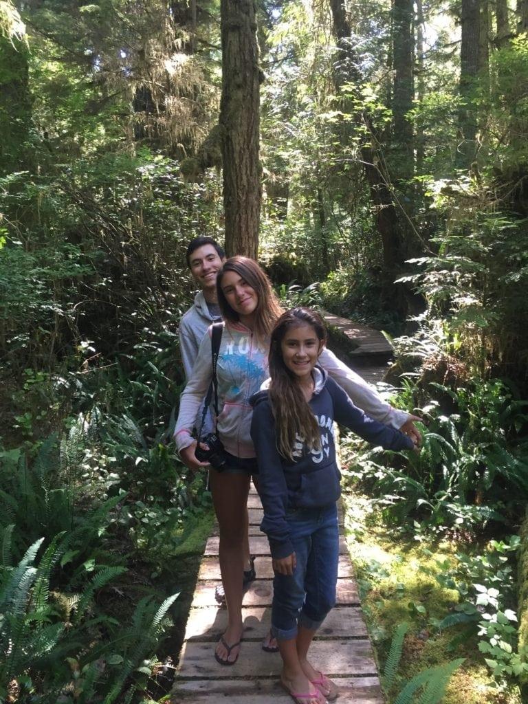 siblings hiking together